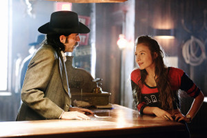"""WYNONNA EARP -- """"Keep the Home Fires Burning"""" Episode 102 -- Pictured: (l-r) Tim Rozon as Doc Holliday, Dominique Provost-Chalkley as Waverly Earp -- (Photo by: Michelle Faye/Syfy/Wynonna Earp Productions)"""